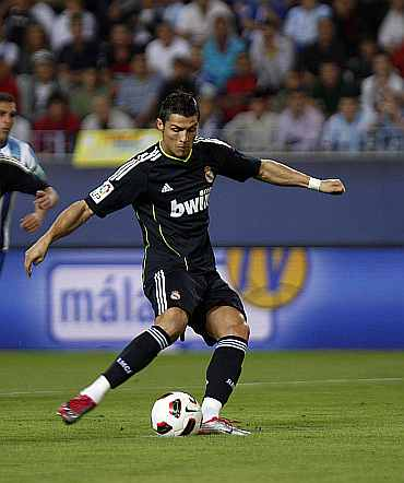 Cristiano Ronaldo shoots a penalty against Malaga