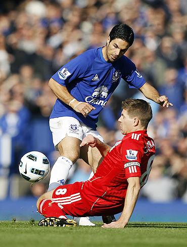 Everton's Mikel Arteta (left) challenges Liverpool's Steven Gerrard during their Premier League match at Goodison Park on Sunday
