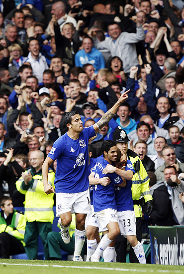 Tim Cahill celebrates after scoring against Liverpool on Sunday