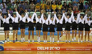 New Zealand's netball team celebrate after winning gold