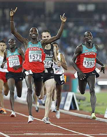 Kenya's Silas Kiplagat (1579) celebrates after winning gold in the men's 1,500 metres finals