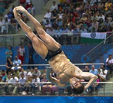 Alexandre Despatie competes in the men's three metre springboard diving final