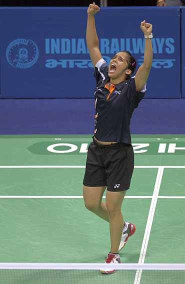 Saina Nehwal reacts after winning gold