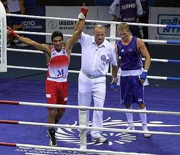 Manoj Kumar reacts after winning his bout