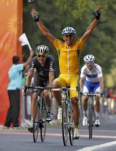 Australia's Allan Davis celebrates after crossing the finish to win the gold medal