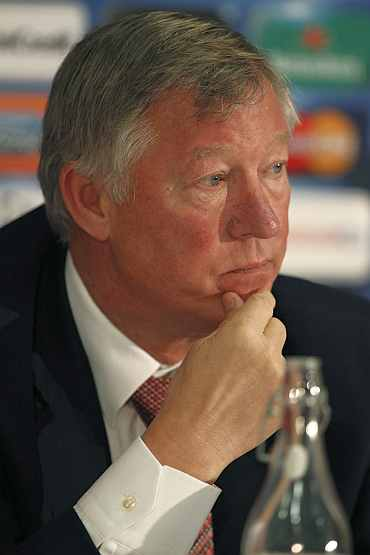 Alex Ferguson reads a statement about the future of Wayne Rooney following a news conference at Old Trafford