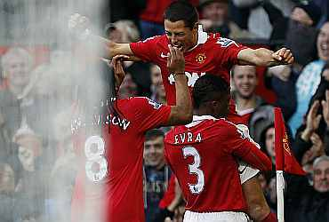 Javier Hernandez celebrates with team-mates after scoring a goal