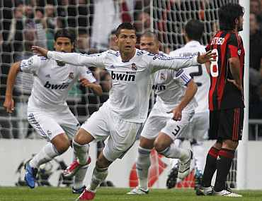 Cristiano Ronaldo reacts after scoring against AC Milan
