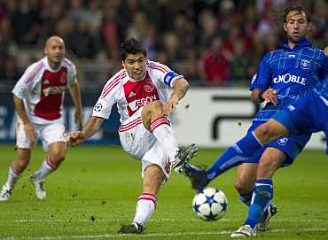 Ajax Amsterdam's Luis Suarez shoots during their Champions League match