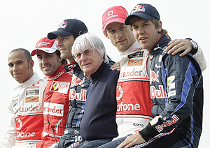 McLaren's Lewis Hamilton, Ferrari's Fernando Alonso, Red Bull's Mark Webber, McLaren's Jenson Button and Red Bull's Sebastian Vettel pose for pictures with F1 commercial supremo Bernie Ecclestone (centre), at the Korea International Circuit in Yeongam