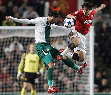 Manchester United's Rafael (right) challenges Bursaspor's Ozan Ipek