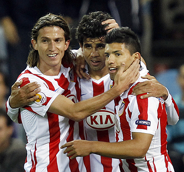 Atletico Madrid's Diego Costa (centre) celebrates with teammates Filipe (left) and Sergio Aguero after scoring against Rosenborg