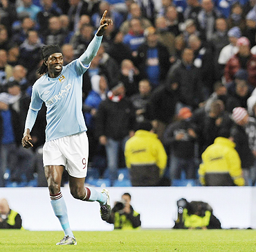Manchester City's Emmanuel Adebayor celebrates his second goal against Lech Poznan
