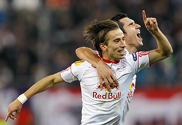 Salzburg's Dusan Svento (left) celebrates with teammate Nikola Pokrivac after scoring against Juventus