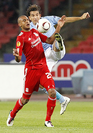 Liverpool's David Ngog (left) and Napoli's Salvatore Aronica vie for possession during their Europa League match