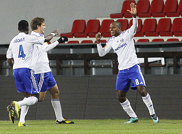 Lausanne's Silvio (right) celebrates with teammates Bigambo Rochat (left) and Jocelyn Roux after scoring against Sparta Prague
