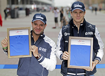 Williams' Formula One drivers Rubens Barrichello (left) and teammate Nico Hulkenberg display casts of their hands for the Driver Wall of Fame exhibition, at the South Korean F1 Grand Prix on Saturday