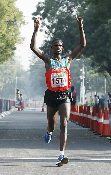 Kenya's John Kelai celebrates after winning the men's marathon at the 2010 Commonwealth Games.