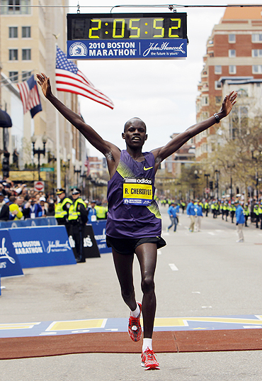 Kenya's Robert Kiprono Cheruiyot crosses the finish line to win the Boston Marathon on April 19.