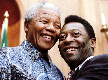 Nelson Mandela (left) with Pele