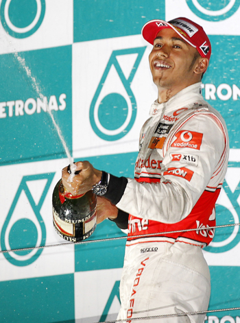 McLaren Formula One driver Lewis Hamilton of Britain sprays champagne as he celebrates on the podium after the South Korean F1 Grand Prix