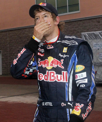 Red Bull Formula One driver Sebastian Vettel of Germany reacts in the paddock after he retired from the South Korean F1 Grand Prix