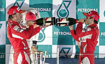 Ferrari's Fernando Alonso and Felipe Massa celebrate after winning South Korean F1 Grand Prix