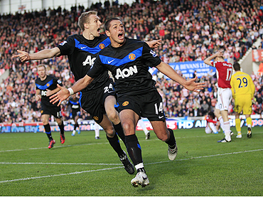 Manchester United's Javier Hernandez (right) celebrates his second goal against Stoke City with Darren Fletcher on Sunday