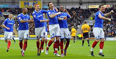 Portsmouth team celebrate after winning
