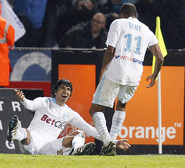 Marseille's Lucho (left) celebrates his goal with teammate Loic Remy during their Ligue 1 soccer match against Lille on Sunday