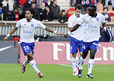 Auxerre's Jean Dennis Oliech (left) celebrates with teammates after scoring against Paris St Germain during their Ligue 1 soccer match on Sunday