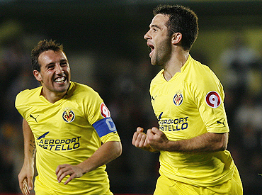 Villarreal's Giuseppe Rossi (right) celebrates with teammate Santiago Cazorla after scoring against Atletico Madrid on Sunday