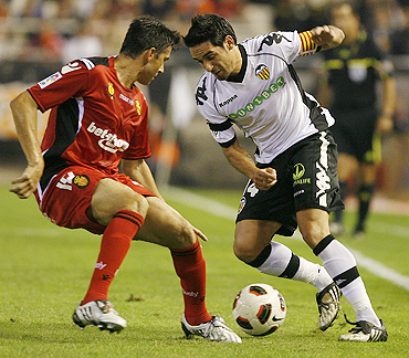 Valencia's Vicente Rodriguez (right) and Real Mallorca's Jose Luis Marti are involved in a duel during their La Liga match on Saturday