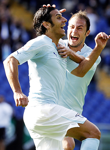 Lazio's Sergio Floccari (left) celebrates with teammate Stefan Radu after scoring against Cagliari on Sunday