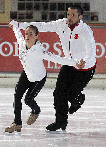 Ilhan Mansiz, former soccer player of the Turkish national team and his girlfriend Olga Bestandigova practice figure skating