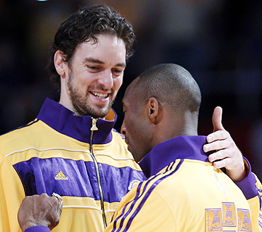 Los Angeles Lakers Kobe Bryant (right) hugs teammate Pau Gasol after receiving their NBA Championship rings from NBA Commissioner David Stern in Los Angeles on Tuesday