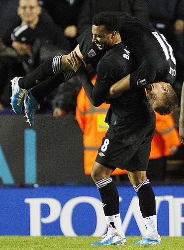 West Bromwich Albion's Simon Cox (right) celebrates his second goal against Leicester City with Giles Barnes