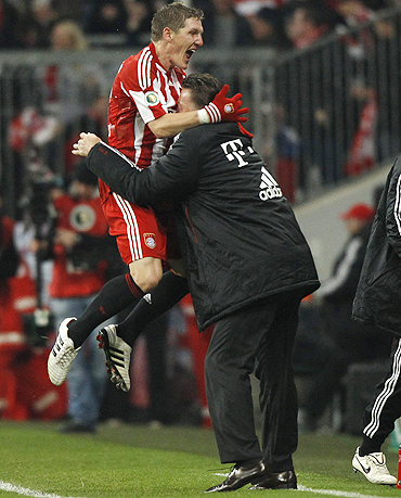 Bayern Munich's Bastian Schweinsteiger celebrates with coach Louis van Gaal after scoring against Werder Bremen on Tuesday
