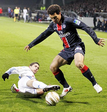 Olympique Lyon's Jeremy Pied (left) challenges Ceara of Paris St Germain