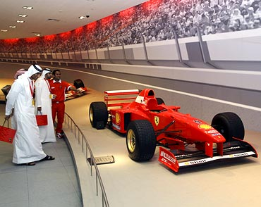 Visitors attend the opening of the world's biggest indoor theme park Ferrari World in Abu Dhabi