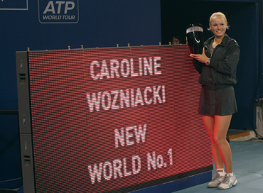 Caroline Wozniacki posses with the women's world number one trophy after defeating Petra Kvitova of the Czech Republic at the China Open