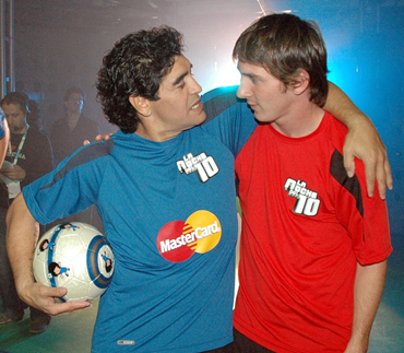 Diego Maradona (L) hugs Lionel Messi of Spain's Barcelona during his weekly television show The Night of the 10 in Buenos Aires