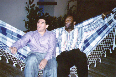 Pele and Diego Maradona sit together at a reception in Rio de Janeiro on May 14, 1995
