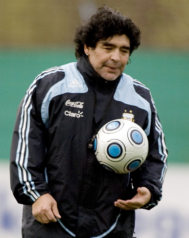 Diego Maradona holds a ball during a training session at the squad's camp in Buenos Aires