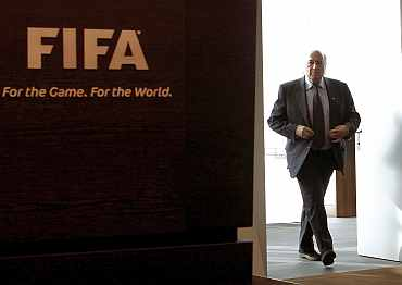 FIFA president Sepp Blatter arrives before a news conference at the FIFA headquarters in Zurich
