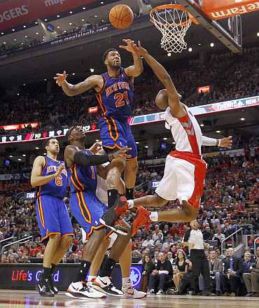 Toronto Raptors' Jarrett Jack jumps in the air against New York Knicks' Wilson Chandler (21) during their NBA basketball game