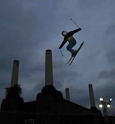 Snowboarders and freestyle skiers practice ahead of International Big Air event at Battersea power station in London