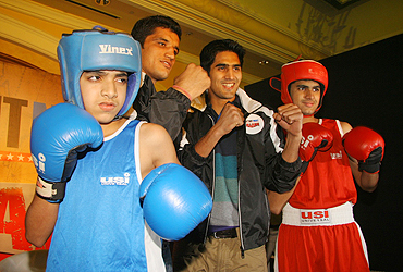 Dinesh Kumar and Vijender Singh with young boxers Moin Darvesh (right) and Owais Darvesh