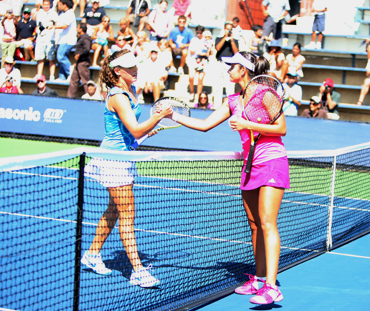 Sania Mirza (right) greets Michelle Larcher de Brito after winning her first round match on Monday