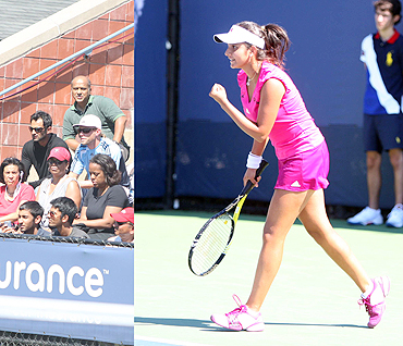 Sania Mirza is pleased as punch after her first round win while husband Shoaib Malik looks on